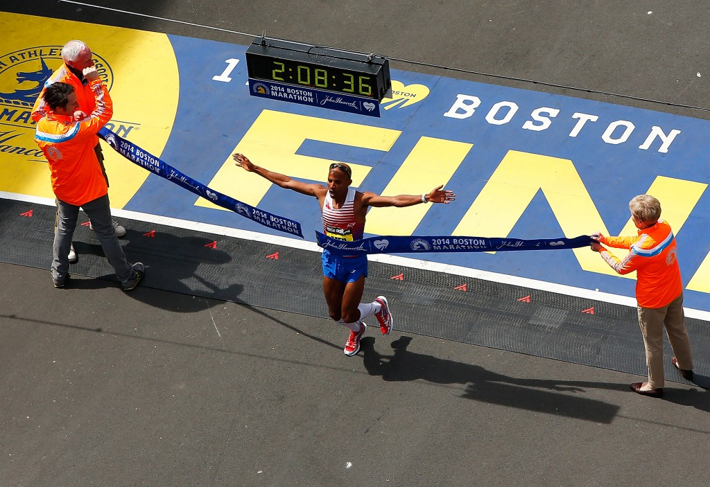 BOSTON, MA - APRIL 21: Meb Keflezighi of the United States crosses the finish line in first place to win the 2014 B.A.A. Boston Marathon on April 21, 2014 in Boston, Massachusetts. Meb becomes the first American winner of the Boston Marathon since 1983. Today marks the 118th Boston Marathon; security presence has been increased this year, due to two bombs that were detonated at the finish line last year, killing three people and injuring more than 260 others. (Photo by Jared Wickerham/Getty Images) ORG XMIT: 459367095 ORIG FILE ID: 485910909