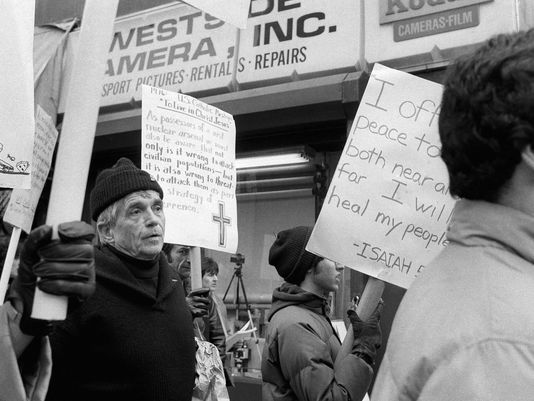 This April 9, 1982, file photo shows Daniel Berrigan marching with about 40 others outside of the Riverside Research Center in New York. The Roman Catholic priest and Vietnam war protester, Berrigan has died. He was 94. Michael Benigno, a spokesman for the Jesuits USA Northeast Province, says Berrigan died Saturday, April 30, 2016, at a Jesuit infirmary at Fordham University. (Photo: AP)